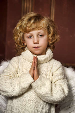 the blond boy with wings of an angel Stock Photo - 13497695