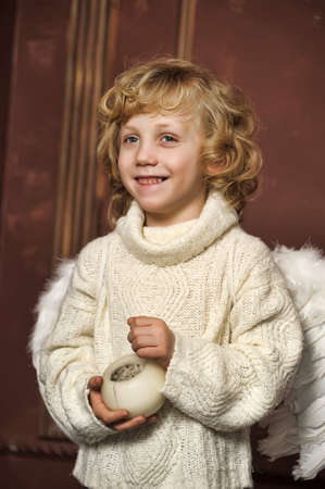 the blond boy with wings of an angel photo