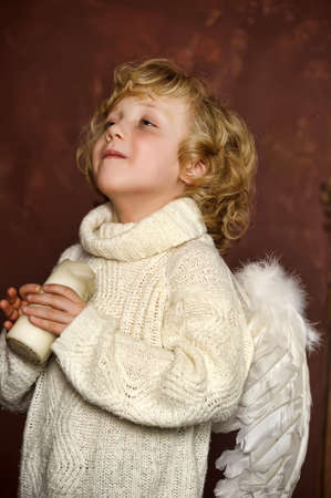 the blond boy with wings of an angel Stock Photo - 13562256