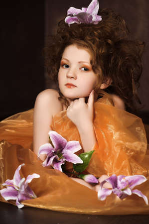 girl with lilac lilies in her hair photo