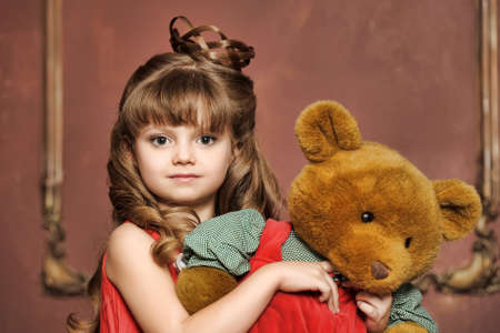 girl with a teddy bear photo