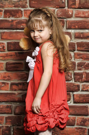 the little girl throws a toy bear Stock Photo - 13756719