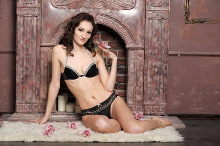 young brunette in lingerie with orchids Stock Photo - 17264050