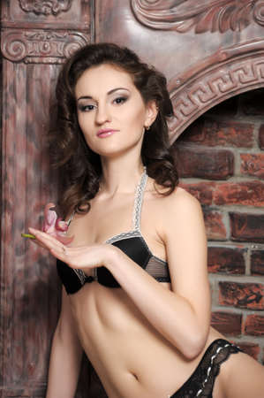 young brunette in lingerie with orchids Stock Photo - 17263962