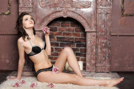 young brunette in lingerie with orchids Stock Photo - 17264079