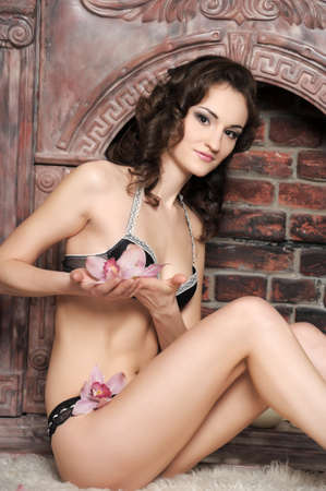 young brunette in lingerie with orchids Stock Photo - 17263955