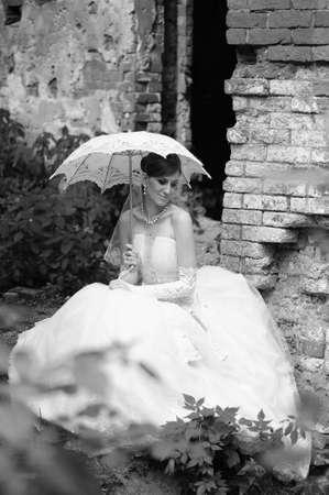 Bride sitting on ruins photo