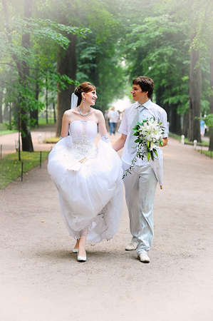 married couple walking along the alley photo