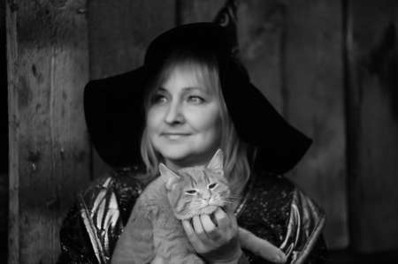 Witch with a cat in her arms photo