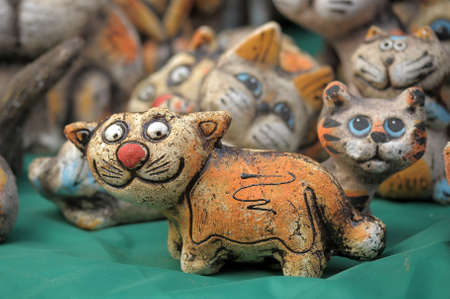 Amusing ceramic figures of cats