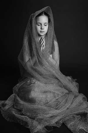 Young and beautiful girl praying Stock Photo - 13445210