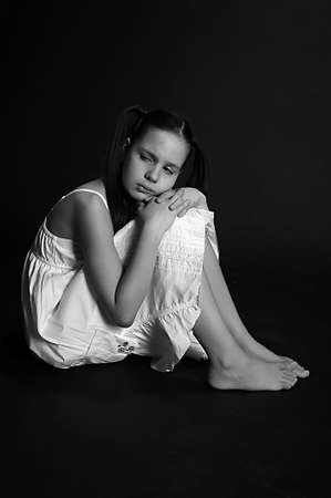 The girl the teenager in depression on a black background Stock Photo - 13444913