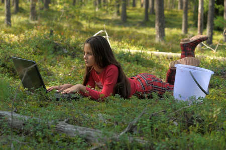 girl with laptop in the woods Stock Photo - 13465805