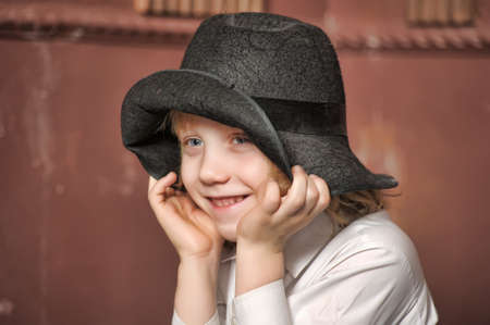 portrait of blonde boy wearing a hat photo