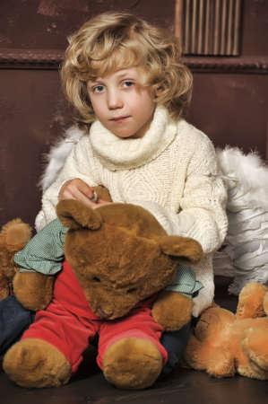 Little cute boy with his teddy bear photo