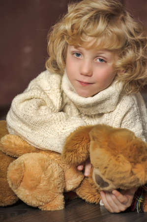 Little cute boy with his teddy bear photo