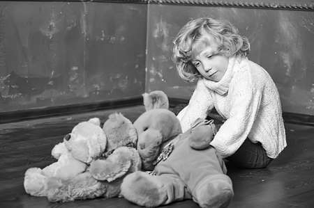 Little cute boy with his teddy bears photo