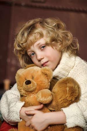 Little cute boy with his teddy bears photo