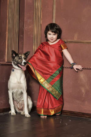 Indian girl in a suit with a dog photo