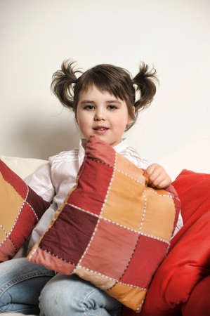 little girl with pillows photo