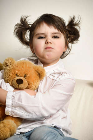 girl with toy bear cub photo