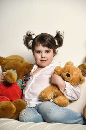 girl with toy bear cubs Stock Photo - 14235525