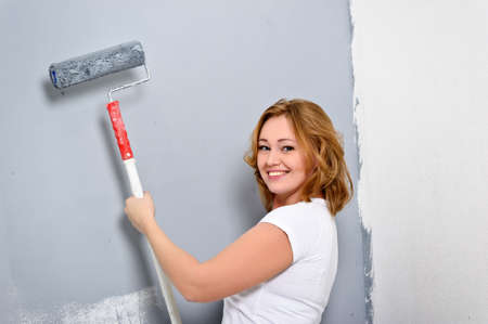 the girl paints a wall photo