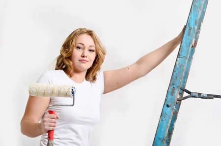 Beautiful young woman doing repairs Stock Photo - 14235414