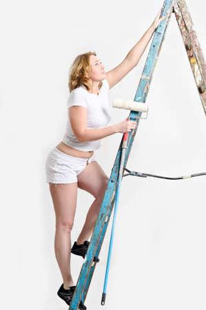 Beautiful young woman doing repairs  Stock Photo - 14237171