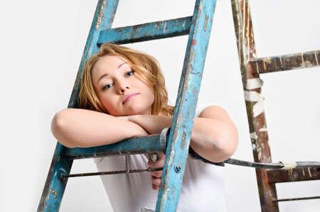 apartmant: Beautiful young woman doing repairs