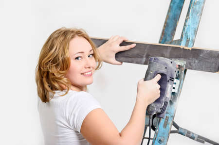 girl with a jigsaw and board  photo