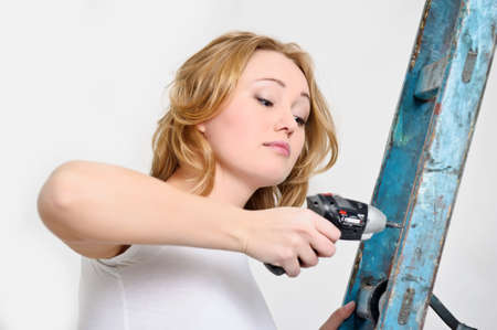 girl with a screwdriver Stock Photo - 13727425