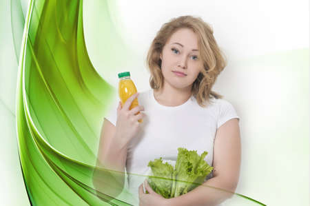 the girl with lettuce leaves and orange juice photo