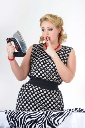 The housewife with the iron  Stock Photo - 13502242
