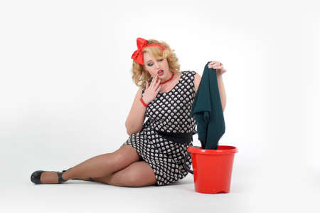 beautiful blonde is engaged in house cleaning  Pin up Stock Photo - 13501059