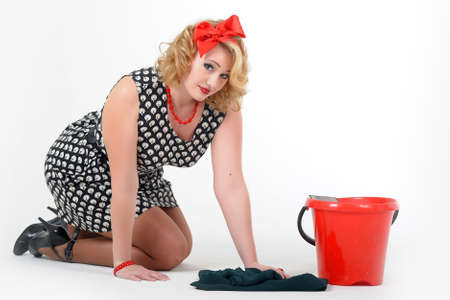 beautiful blonde is engaged in house cleaning  Pin up photo