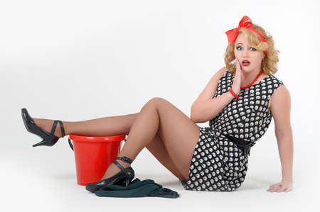 beautiful blonde is engaged in house cleaning  Pin up Stock Photo - 13501044