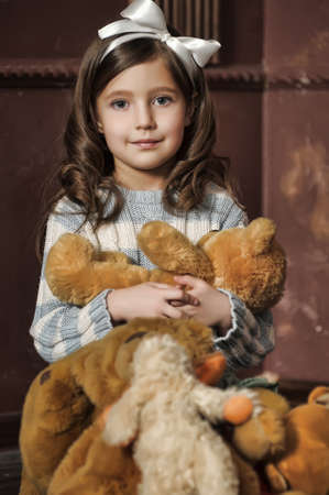 dirty blond: little girl with toy bear-cubs