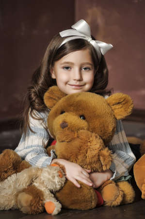 little girl with toy bear-cubs Stock Photo - 13684115