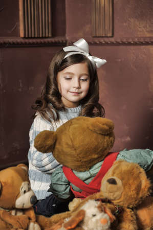 favorite colour: little girl with toy bear-cubs