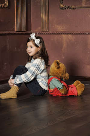 Girl with plush bear photo