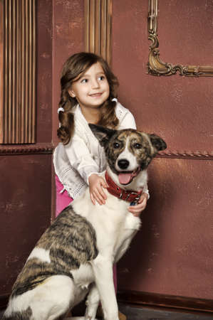 Portrait of a little girl with dog photo