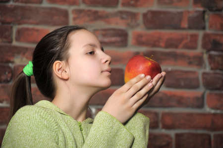 Teen girl with red apple in his hand
