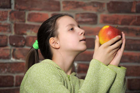 Teen girl with red apple in his hand  photo