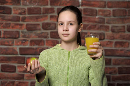 teen girl with an apple and orange juice  photo