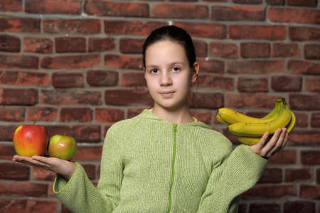 Girl holding fruits photo