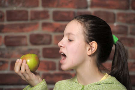 Teen eating green apple  Stock Photo - 14235419