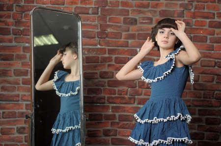 the girl admires itself in a mirror Stock Photo - 13684051
