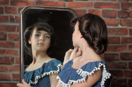 the girl admires itself in a mirror Stock Photo - 13684041