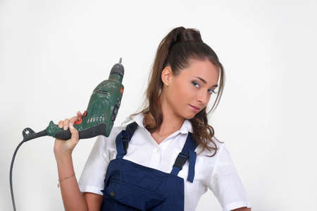 Beautiful girl with a drill Stock Photo - 13684009
